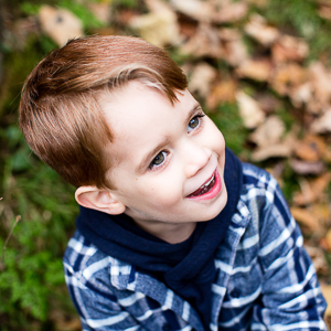 boy having fun in woods for headshot photography