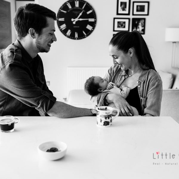 newborn with family in kitchen very happy
