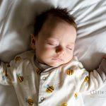 baby asleep on bed at 9 weeks old