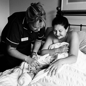 mum and midwife with baby after birth