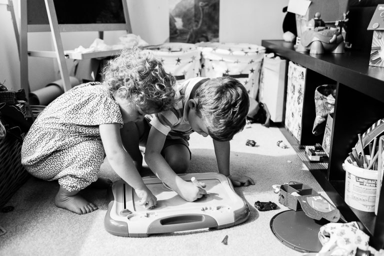 kids playing together at home at a day in the life photo session