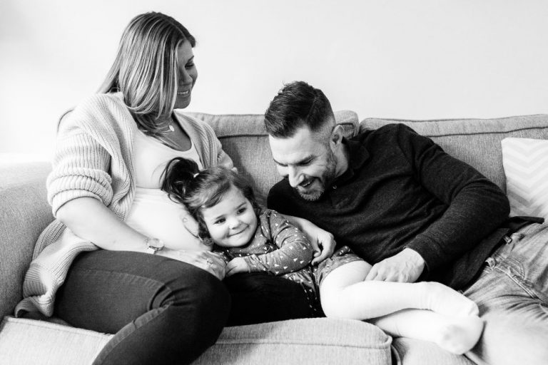 Lady 35 weeks present with husband and daughter on sofa