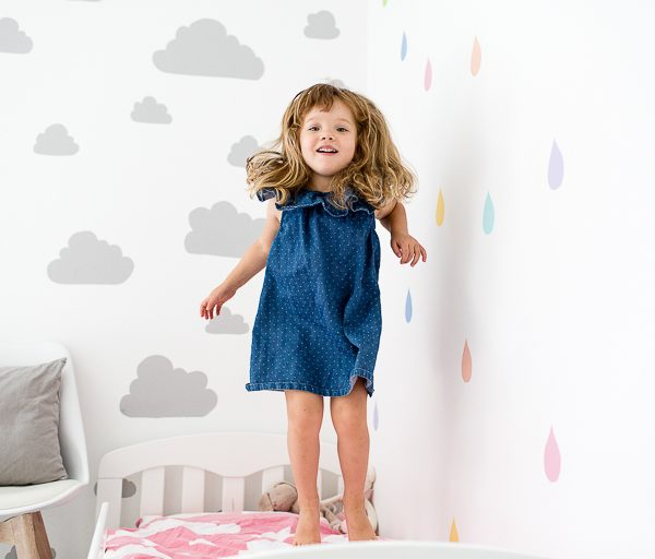 girl jumping on bed having fun