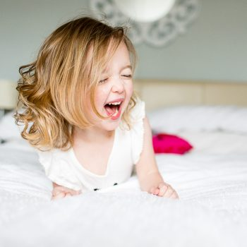 girl screaming out loud in bedroom