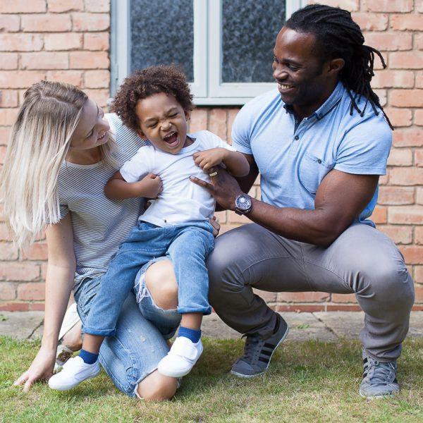 family fun in garden tickling to laugh