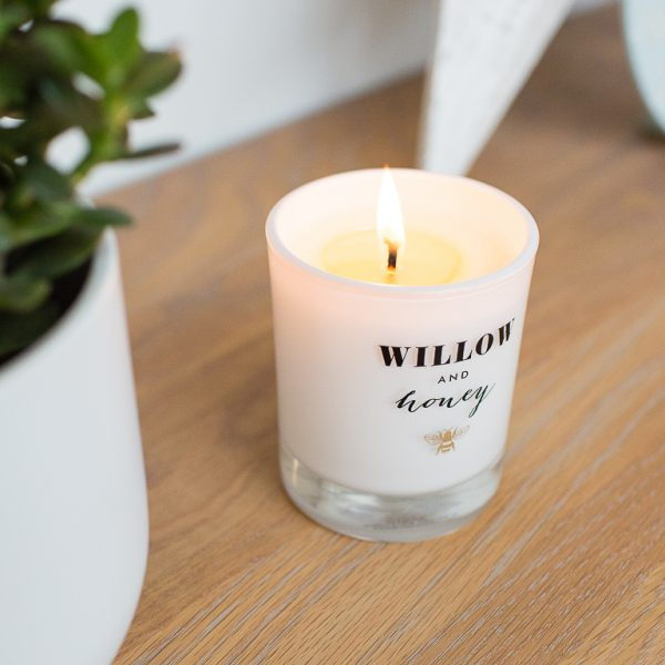 lit candle displayed on side for photography