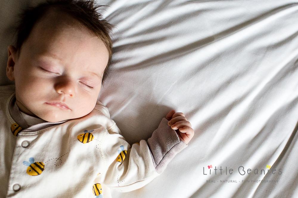 newborn baby sleeping on the bed