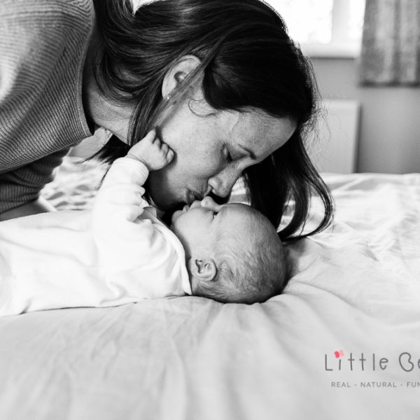 mum-with-newborn-baby-kissing