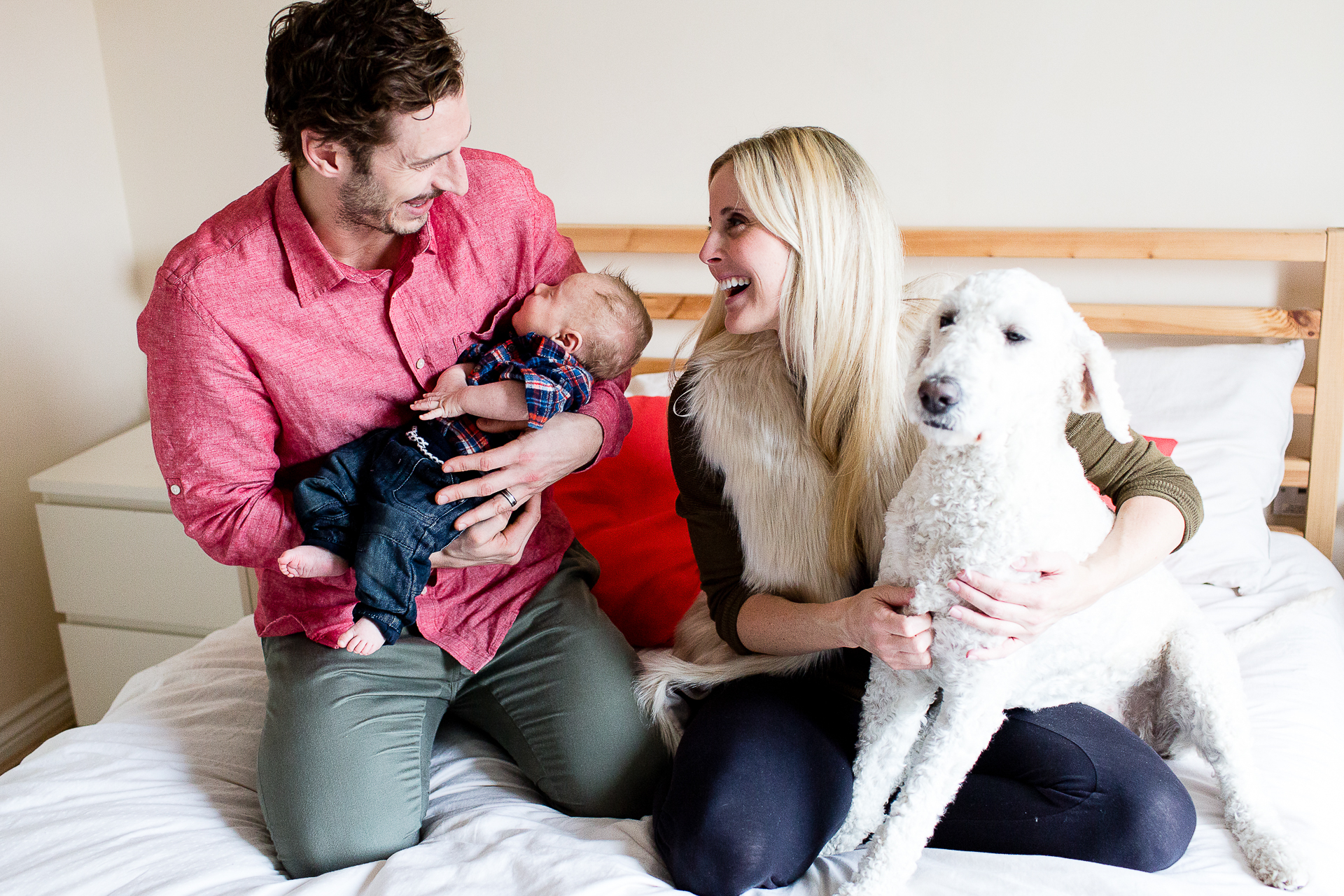Photography of the Robinson family including the dog on this newborn baby photo session
