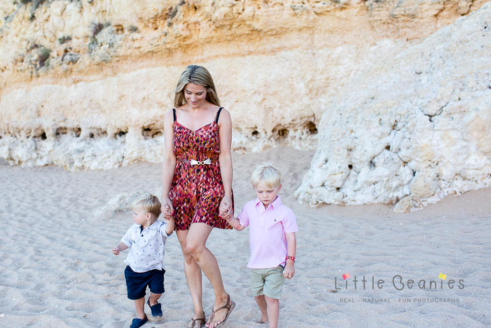 Lisa Jordan walking on the beach with her two boys very happy and content