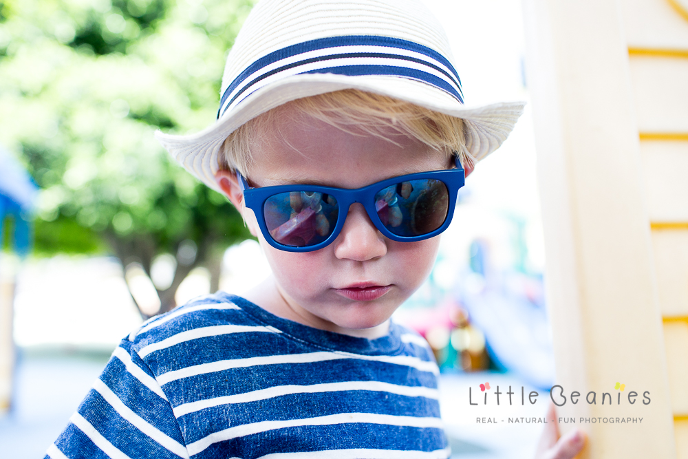 Boy looking cool in sunglasses and hat
