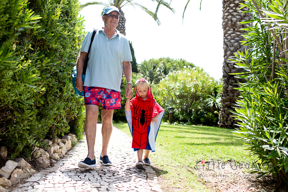 Grandson and Grandfather walking on holiday