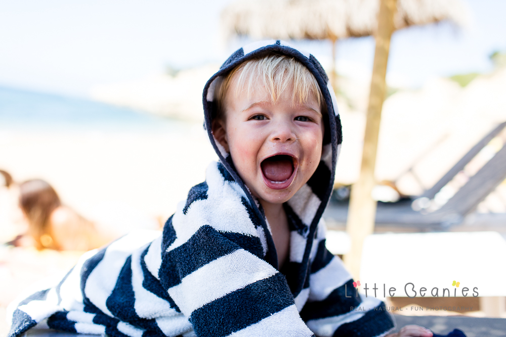boy on beach screaming at camera