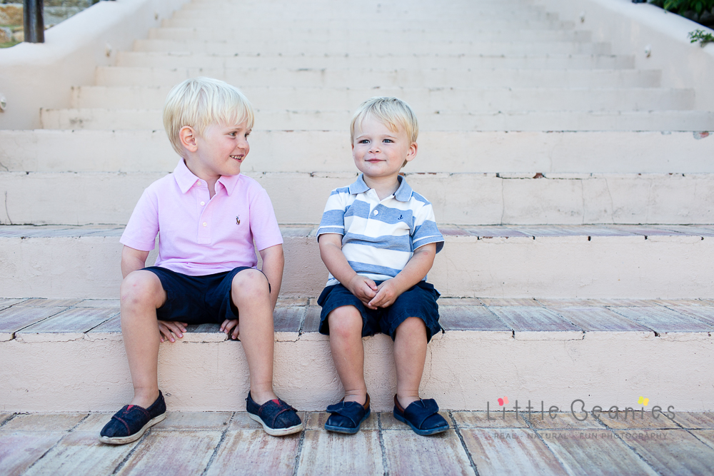 Lisa Jordan's boy's from Little Beanies photography on the steps laughing and joking together