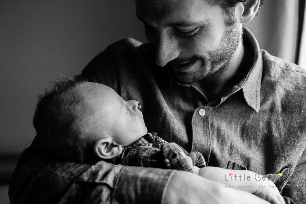photograph of special moment with daddy and newborn baby