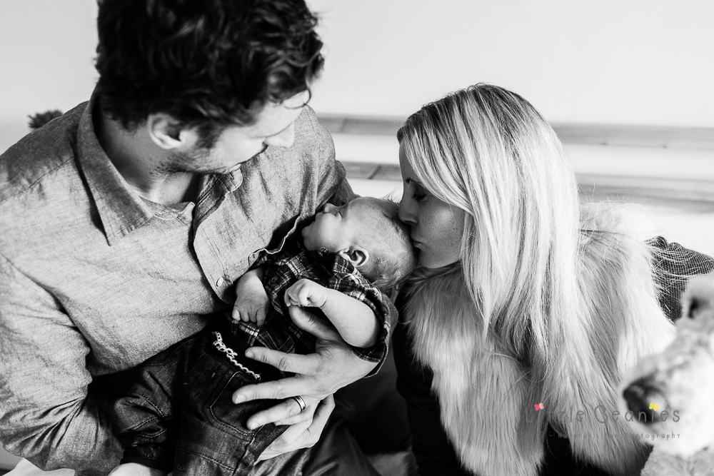 newborn baby photography with mum and dad on bed