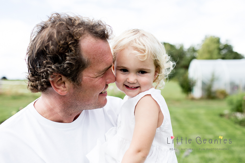 daddy and her baby girl on at Kenilworth newborn photoshoot